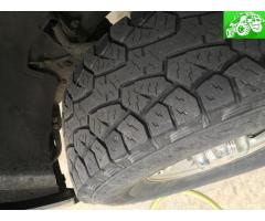 STOCK GM 8lug wheels w/ 285/75/16 Handkook tires that have 25-30% tread left! Make offer!