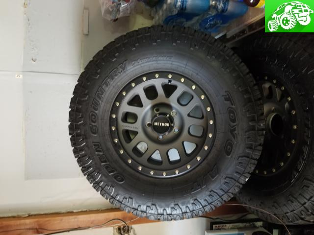 Four 35x12.5x17 LT Toyo Open Country AT 2 on Method 309 wheels